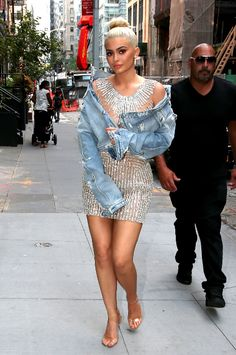 Kylie Jenner struts the streets of NYC in a totally casual crystal embellished mini dress and distressed jean jacket.