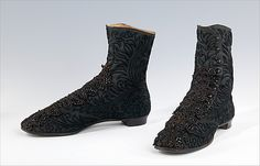 Wool, silk, and cotton boots, 1865-75. Heavy soled walking shoes, like this pair of button boots, were seldom ornamented with anything more than a simple bow or buckle. Hence, the beaded cordwork was most likely applied by the wearer.