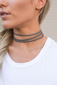 We're obsessed with the classic cool of the Triple Threat Braided Choker Necklace! Soft, braided vegan leather choker has gold clasps that fasten behind the neck. Other colors sold separately.