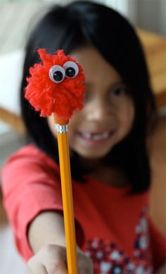 pom pom pencil. I bet daughter will love this!   need to find that glue gun! (elmers glue just doesn't seem to cut it w/ most projects?)