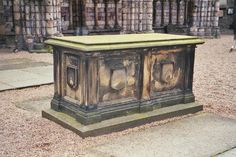 Abbey of Holyrood, Edinburgh -  the coffins of James V, Magdalen, his 1st wife, & his infant sons by his 2nd wife Mary of Guise were placed in this vault after their burial site was destroyed by the English Army in 1544. The tomb was damaged in 1688 by riots during James VII's reign. Queen Victoria ordered repairs & all of the remains of those previously interred were reburied in one coffin. The vault also contains the coffin of Mary of Gueldres, Queen of James II.