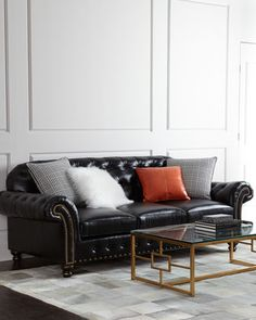 Blackburn Sofa by Massoud at Horchow.  The sofa includes a chic mix of pillows (love the shaggy lambswool).