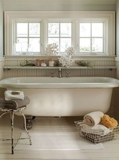 free standing tub with rustic metal stool....like the ledge above tub for toiletries