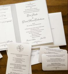 Another silver in gray invitation set wtih seriously pretty calligraphic flourishes and monograms.