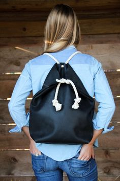 the hustler minimal black backpack // black buffed, waxed cow hide, hand-stitched with sinew // cotton rope straps // hustling companionship at its