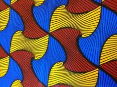 """This 100% cotton African Wax print fabric with yellow, red and blue eye catching designs (389-W33). This fabric is sold by the yard (36""""w x 45""""l). Fat Quarters are available. Wholesale and international shipping."""