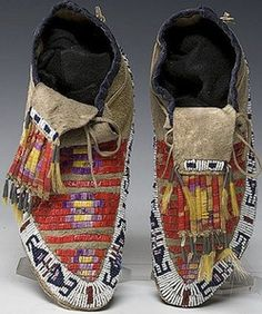 native american, America, Sioux beaded and quilled hide moccasins, first quarter 20th century, thread- and sinew-sewn using bead colors of c...
