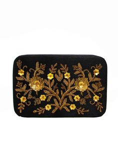 An instant classic, this elegant clutch features contrasting coloured golden embroidery on a black silk base. Neutral coloured, this clutch is perfect to match with outfits of any style!