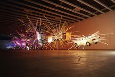 Cai Guo-Qiang Inopportune: Stage One, 2004 Cars and sequenced multi-channel light tubes 192 × 72 in 487.7 × 182.9 cm Seattle Art Museum