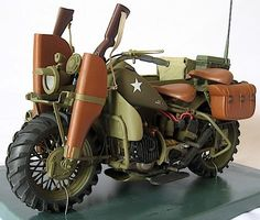 """Customizer Creates Scale Replica of 1942 Harley-Davidson Army Prototype """"Model XS"""" Opposite view showing dual rifle scabbards, two seats, radio, saddlebag and unique """"tractor"""" tires. Futuristic Motorcycle, Motorcycle Bike, Motorcycle Touring, Motorcycle Quotes, Motorcycle Decals, Vintage Bikes, Vintage Cars, Retro Vintage, Cool Motorcycles"""