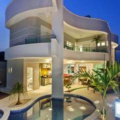 Casa Orquídea: Casas Moderno por Arquiteto Aquiles Nícolas Kílaris