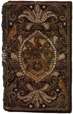 Embroidered binding in purple satin with seed pearls and bullion on a copy of The Whole Book of Psalms, London, 1641.