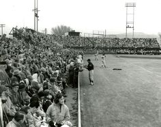 A player signs autographs for fans at Derk's Field is seen in this undated photo. (Tribune file photo)