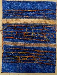 several layers of fabric, rows of stitching, and slashing to reveal lower layers..... Mixed Media