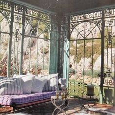 Love this Bohemian garden room with those awesome windows!
