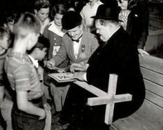 Meeting young fans and signing autographs while on location filming 'Blockheads'