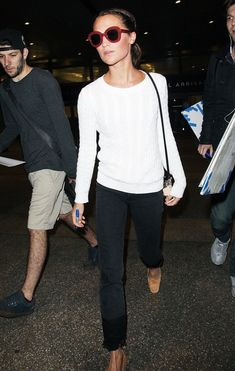 Alicia Vikander takes a practical approach to airport dressing—taking to the skies in a pared-down outfit formula that's effortlessly chic.