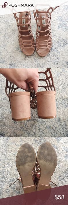 """{Steve Madden} IRA Cage Heeled Sandal Take any ensemble to the next level with Ira, featuring a trendy caged upper on a chunky block heel. Pairs perfectly with dresses and skirts or denim!   Worn a couple times. Only flaw is the spot of honey that was dropped on the shoe... 🙈 See last photo. Sold out c o n t e n t + leather  c o l o r + Nude  m e a s u r e m e n t s ✂️ + 2.5"""" block heel    p a i r  w i t h 🌙  + Clayton Sarah Skirt   + Lacey Pom Blouse 💵 bundle for a discount Steve Madden…"""