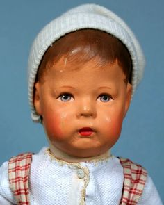 """17"""" stuffed and painted cloth Type I doll, wearing period girls' smock, Germany, 1930-39, by Käthe Kruse."""