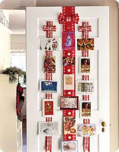 {CHRiSTMaS CaRD DiSPLaY} aTTaCH To a DooR WiTH LoNG RiBBoN. PuNCH HoLe iN ToP oF eaCH CaRD & PLaCe a TiNy RiBBoN we did something like this. so cute THRouGH, THeN Tie & HaNG FRoM THe BuTToNS oN THe LaRGeR RiBBoN.