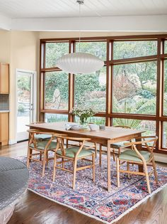 A Nelson saucer pendant lamp casts a warm glow over the dining room. Dining Room Wainscoting, Dining Room Wallpaper, Dining Room Curtains, Dining Room Lighting, Mid Century Modern Dining Room, Dining Room Inspiration, Dining Room Design, Home Design, Interior Design