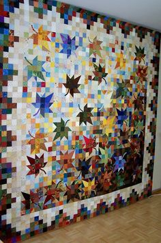 The raffle quilt for the Assiniboine Circle Quilter's quilt show is off my design wall and at the longarmer's to be quilted. Thousands of squares were cut out of fabrics donated by our guild's members