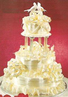 This unique wedding cake is covered with ribbons made from spun sugar ...