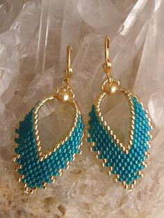 FREE SHIPPING on these earrings in the USA & Canada! These pretty Russian leaf earrings are handmade with deep teal rainbow, & golden delica seed beads with golden Swarovski glass pearls. They measure just under 2 long including the plated leverback earwire. The leaf itself measures just under 1-1\/2 long, & 7\/8 wide.