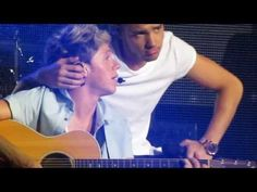 """Little Things live at the Staples Center. Niall starts crying and his voice breaks so Liam comes and comforts him..... Niam <3 Also can I just throw out there how much I love that Harry says """"and you're perfect to me"""" here instead of """"but you're perfect to me"""". When you say 'but', it implies that all the stuff about the voice on tape/squeezing into jeans is a problem. But instead he says AND you're perfect to me. Because that stuff doesn't matter."""