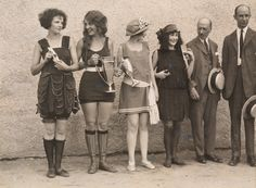 1920s swimwear and trophy winners:I love the fact that 1920s swimwear was so diverse and individual. Girls in summer attire hold cup, ribbons, and awards they've won in Washington D.C., 1923. None of them look like they've actually got wet though do they? I wonder what the trophies were for…? Photograph by Maynard Owen Williams, National Geographic