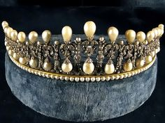 Bavarian Pearl Tiara in the Residenz Museum in Munich. Attributed to Caspar Rieländer, the famous Munich court jeweller, ca 1825, was made for Queen Therese of Bavaria, Pss of Saxe-Hildburghausen 1792-1854. 16 diamond arches with pearl drops hanging from lover's knot bows, topped with pear shaped pearls (photo by atsubor, via Flickr).  See earlier pin for alternate view