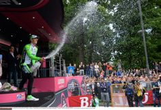 Giro d'Italia 2014 - Stage 13 - Marco Canola (Bardiani CSF) spray the stage winners champange