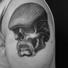 Skull in flat cap point work by Chris Garver