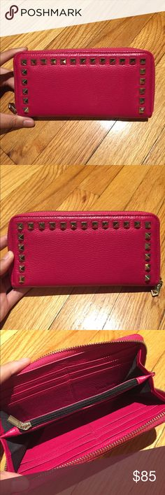 Pink Neiman Marcus Zip Around Continental Wallet -Almost new condition -Pink zip around continental wallet with gold spikes -12 card slots -A zippered coin pouch in the middle Neiman Marcus Bags Wallets