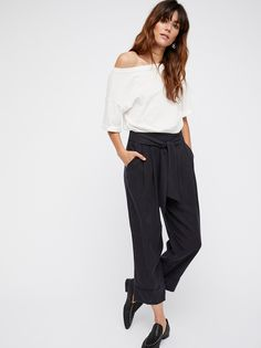 Hawaii Jumpsuit | Pleated trouser sit atop a classic white cotton tee in this effortless jumpsuit.    **Top:**   Slouchy fit   Semi-sheer   Cuffed sleeves   Cutout detailing at the waist   **Pants:**   Pleated    Hip pockets   Adjustable waist tie   Cropped inseam