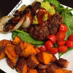 BBQ bison bunless burger for lunch with garlic and herb roasted sweet potatoes.✨ Topped my burger with onion and mushrooms sautéed in ghee... and a little guacamole on top too.✨ I has so HANGRY it was super hard taking this picture before I ate lol. #FoodieProblems  https://www.facebook.com/TeamJERF