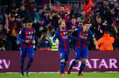 Luis Suarez (R) of FC Barcelona celebrates with his teammates Neymar Santos Jr (L) and Lionel Messi (C) after scoring the opening goal during the La Liga match between FC Barcelona and Real Madrid CF at Camp Nou stadium on December 3, 2016 in Barcelona, Catalonia.