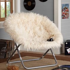 Cosy chair. (could partially DIY by buying a cheap chair at a store like Target, then sewing on your own fuzzy fabric over the original fabric)