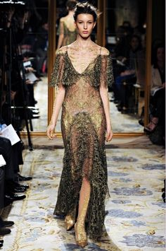 Paris Runway- Marchesa's Georgina Chapman and Keren Craig sent out a chorus of frothy, gilded frocks of the highest order. Their otherworldliness was inspired by William-Adolphe Bouguereau's dramatic nineteenth-century painting A Soul Brought to Heaven