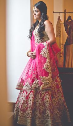 Bright pink bridal lehenga.  Indian wedding #shaadibazaar #Indianweddings