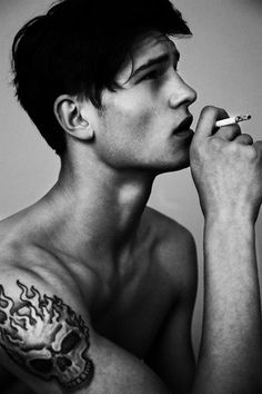 Don't like the tattoo, but I love guys with tattoos :)