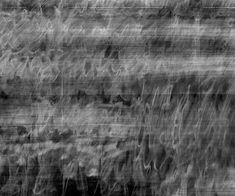 Idris Khan takes photographs of photographs and sandblasts hundreds of minute lines of text on to marble and steel