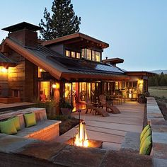 I love pretty much all about it: timeless retreat appeal, huge windows, ability to use solar paneling w/o them being too visible, fireplace nook..I would add some outside music here