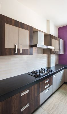 To design a fully functional kitchen which is also modern can sometimes be a challenge. But you with this spacious house the designers have created a modular cooking space which is also easy to maintain. The cabinets have been made using wood whereas the counters are black granite which gives it the durability most people desire. #modularkitchen #modularfurniture #kitchendesign #kitchenremodel #kitchencabinets