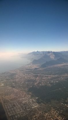 A view from the plane of the snow-capped Taurus mountains and the city of Antalya.