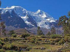 via www.mountainadventures.com  Bolivia. Illimani, from the climber's trailhead.