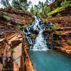Cascading steps at Fortescue Falls, Karijini National Park, Australia.