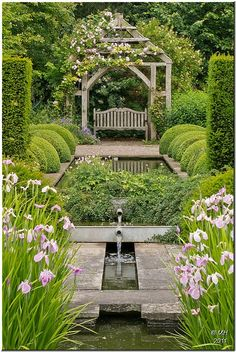 Secret Garden - symmetry with a swinging bench at the far end, fountain down the middle!