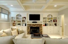 Basement fireplace with built-ins, light colors keep the space feeling open when the windows are small