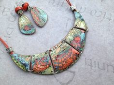 Au fli des pates, mokume gane necklace and earrings made from polymer clay.